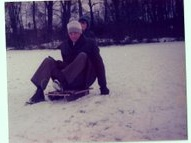 My dad on the sledge he built