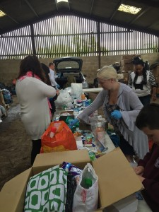 Making up toiletry bags for Calais